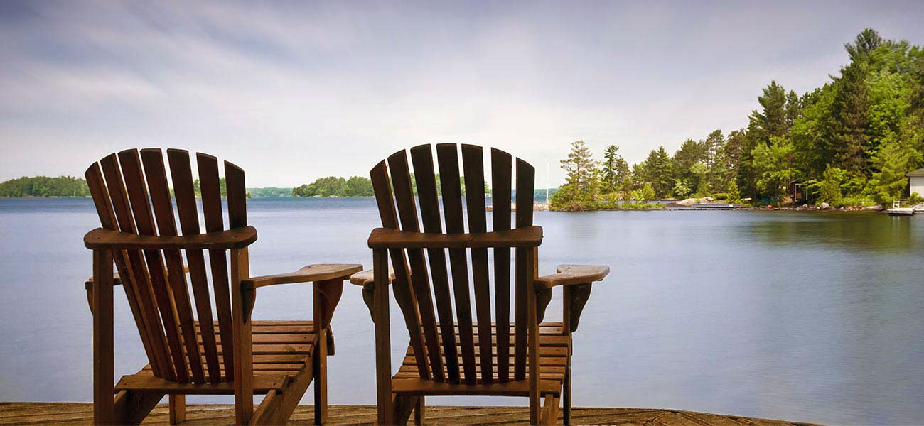 adirondack chairs facing lake george